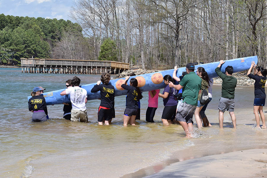 Georgia Tech ASCE's concrete canoe team load their creating into a lake to test its buoyancy at the Carolinas Regional Conference March 31. Weather conditions canceled the traditional (and usually entertaining) canoe races at the conferece. (Photo: Thomas S. Teichmann)