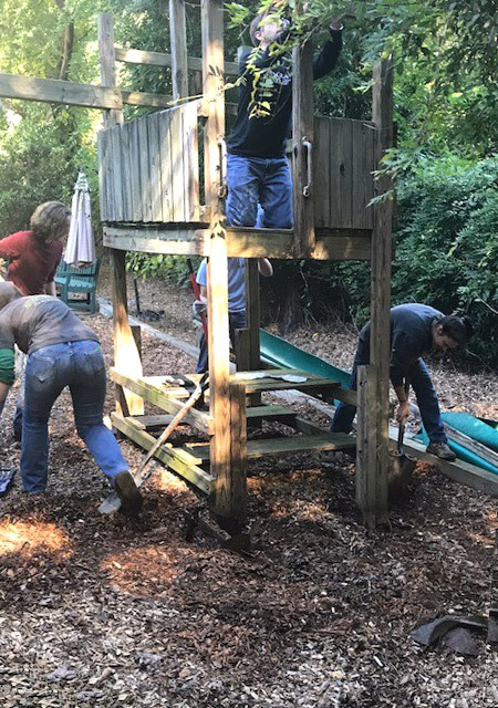 Students from the Georgia Tech chapter of the American Society of Civil Engineers prepare to take down a piece of playground equipment for International Women's House in Decatur, Georgia. (Photo Courtesy: ASCE Georgia Tech)