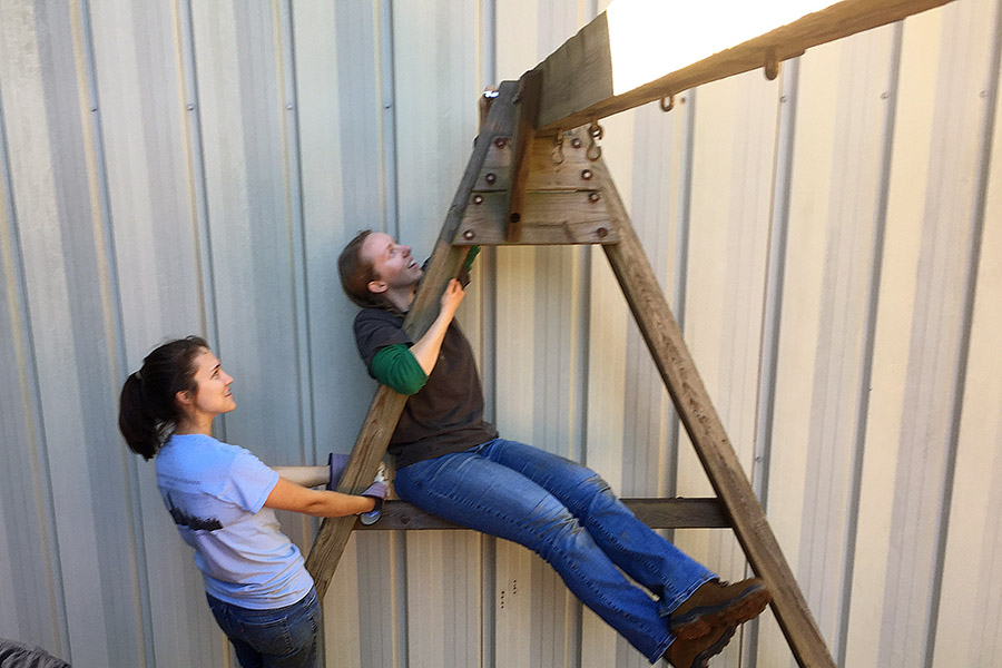 Caroline Stanton and Alesa Stallman from the Georgia Tech chapter of the American Society of Civil Engineers prepare to take down a swing set on International Women's House playground in Decatur, Georgia. (Photo Courtesy: ASCE Georgia Tech)