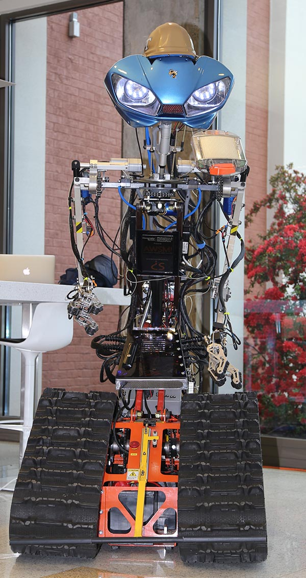 "AWSM — ""Awesome"" or Autonomous Working Smart Machine — is what Dimitri Seneca Snowden calls the robot he built from scratch. Snowden donated the machine to Yong Cho's Robotics and Construction Automation Lab this spring. (Photo: Jess Hunt-Ralston)"