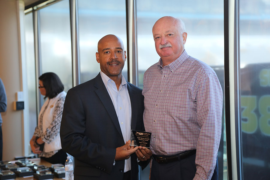 Barry Goodno receives his award from School Chair Reginald DesRoches. (Photo: Jess Hunt-Ralston)