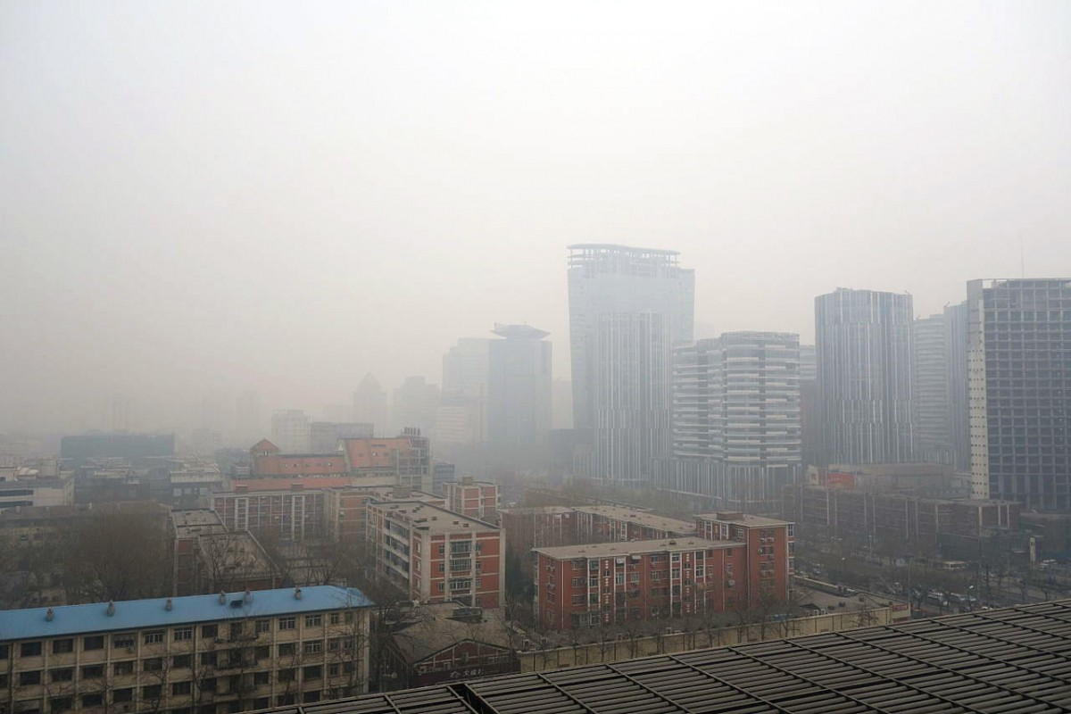 Air pollution hangs over a portion of Beijing, China, obscuring buildings. A new study finds that cities could cut greenhouse gas emissions by a third, significantly improving air quality and health, by adopting a series of strategies to reuse industrial waste. (Photo Courtesy: Humphrey School of Public Affairs, University of Minnesota)