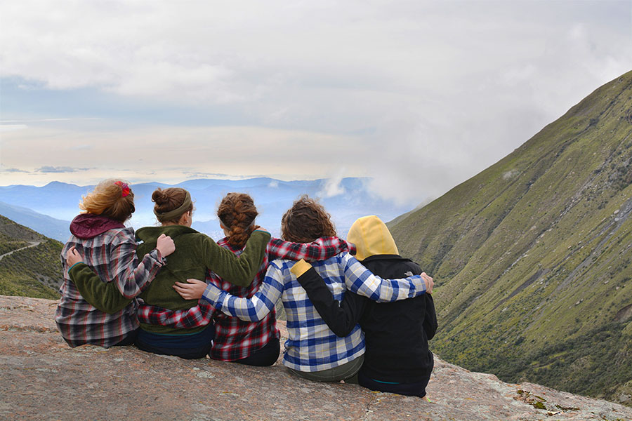 Five students lock arms and take in the view on the way to the top of Mount Tunari in Bolivia. (Photo: Rachel Brashear)