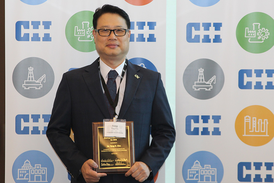 Associate Professor Yong Cho with his Distinguished Professor award from the Construction Industry Institute. (Photo Courtesy: Construction Industry Institute)