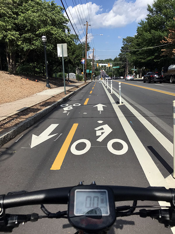 The cycle track along 10th Street in Midtown Atlanta near Piedmont Park provides a physical barrier between two-way bicycle traffic and vehicles. (Photo: Jess Hunt-Ralston)