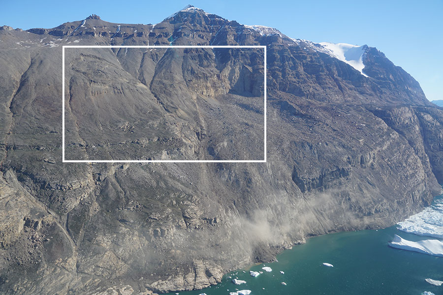 The scarred hillside Greenland's Karrat Fjord after a lanslide fell a kilometer (about 3,300 feet) into the water below, causing a tsunami that reached 300 feet high and has been blamed for four deaths in a nearby town. On the left, another landslide remains active and three towns remain evacuated.
