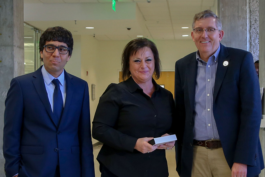 Melisa Hubbs, center, receives her award from awards committee chair Arash Yavari, left, and School Chair Donald Webster.  (Photo: Amelia Neumeister)