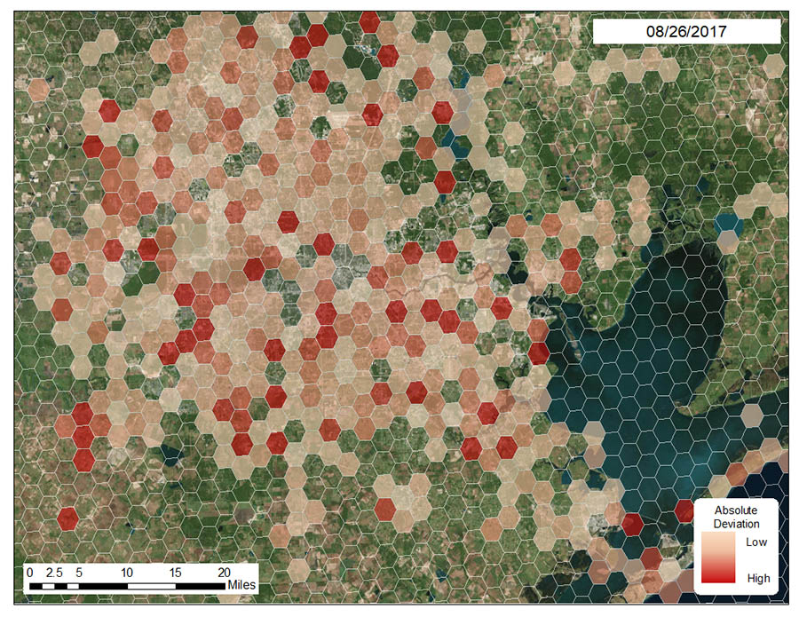 A hexagon grid overlaying Houston shows the reductions in Twitter activity the day following Hurricane Harvey's landfall in August 2017, with darker red hexagons high levels of deviation. (Image Courtesy: Rachel Samuels)