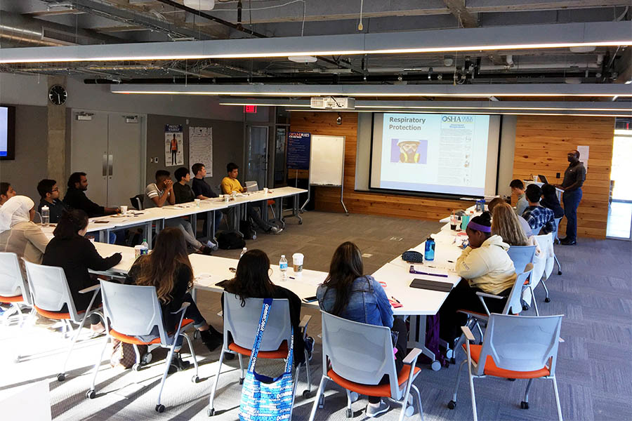 Students from the School of Civil and Environmental Engineering learn OSHA guidelines for worksite safety in early November. The Atlanta office of JE Dunn provided the training — and lunch — to the group of nearly two dozen undergraduate and graduate students. (Photo: Yong Cho)