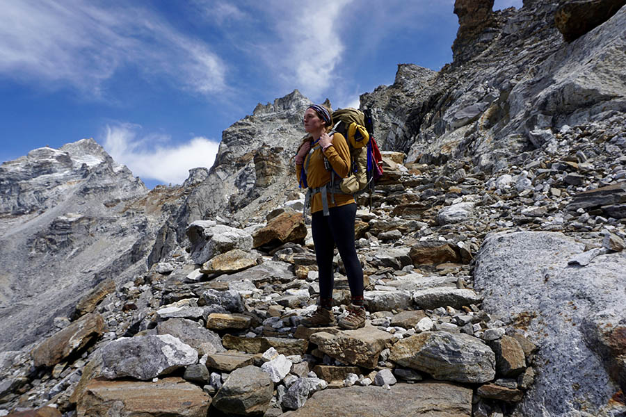 Maggie Lindsey stands on the rocky slope of Mt. Everest in Nepal. Lindsey used Joe S. Mundy Global Learning Endowment funds to support her internship with Miyamoto International in Nepal.
