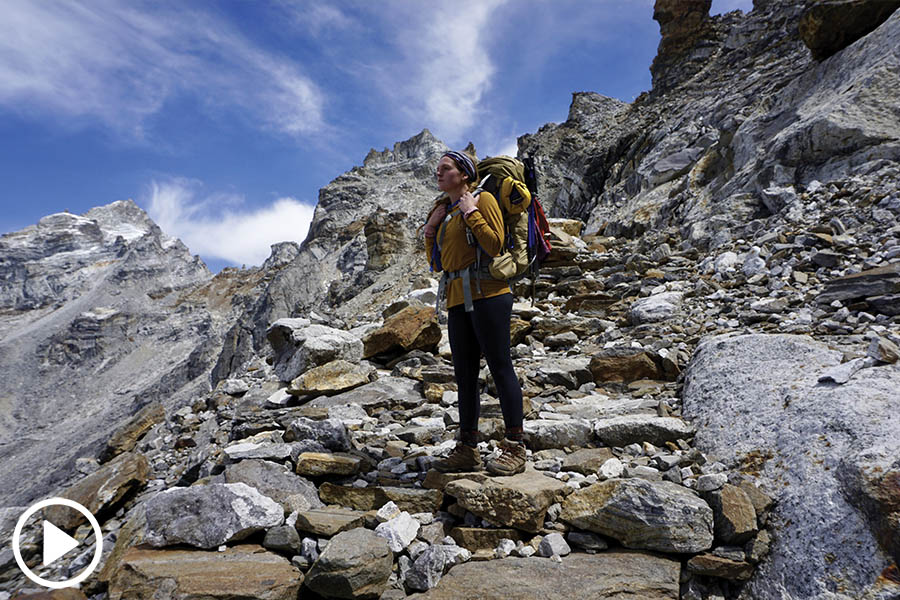 Maggie Lindsey stands on a rocky hillside just below Renjo La Pass in Nepal. (Photo: Uzol Rai)
