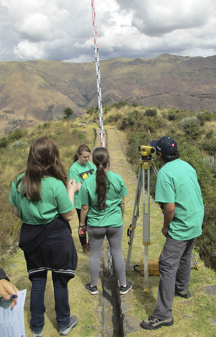 A group of students surveys a dry Incan canal at the religious and agricultural site Tipon in Peru. The group, including Georgia Tech senior Maya Goldman, used a well-known hydraulic modeling software to compare the trial-and-error method of Inca engineers to modern empirical equations. (Photo: Maya Goldman)