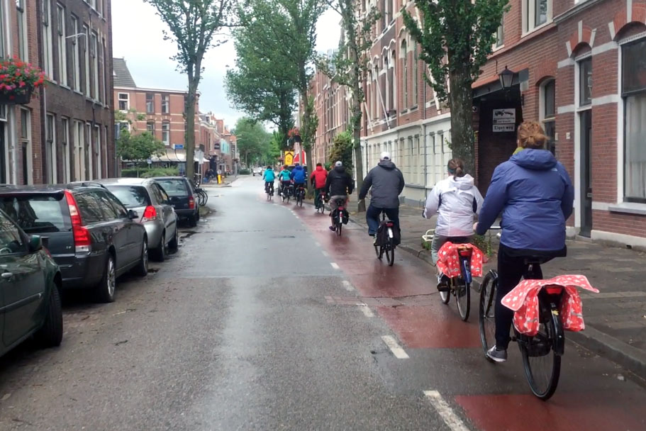 Students in Kari Watkins' Sustainable Transportation Abroad class ride bicycles in the kind of bike lanes that permeate the Netherlands — painted red and running alongside a fairly narrow street. The class spent nearly two weeks riding across the country and exploring the Dutch approach to transportation. (Photo: Anna Nord)