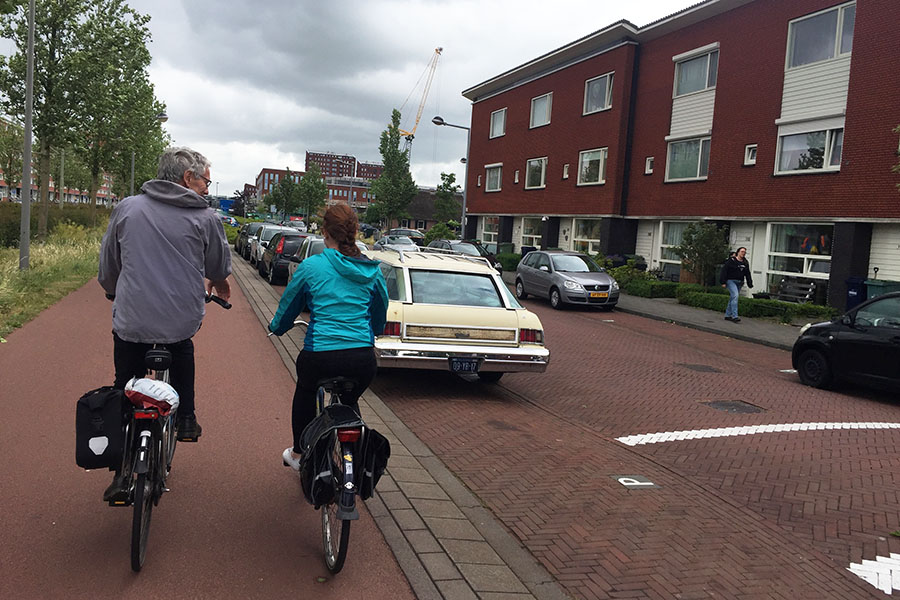 Regional planner and engineer Jan Termorshuizen, left, rides with School of Civil and Environmental Engineering master's student Annie Blissit along a cycle track in the Netherlands in May 2017. Termorshuizen was one of the local officials who helped teach students in Kari Watkins' Sustainable Transportation Abroad class about the Dutch transportation system. (Photo: Anna Nord)