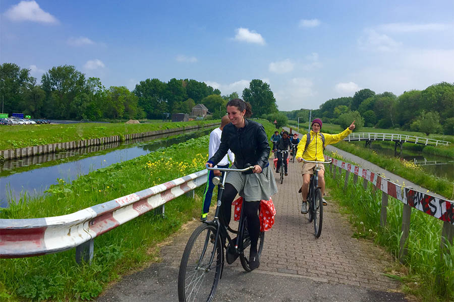 Teaching assistant Alice Grossman leads a group of School of Civil and Environmental Engineering students along a bike trail in the suburban area of Leidschenveen-Ypenburg in May 2016. (Photo: Sustainable Transportation Abroad class)