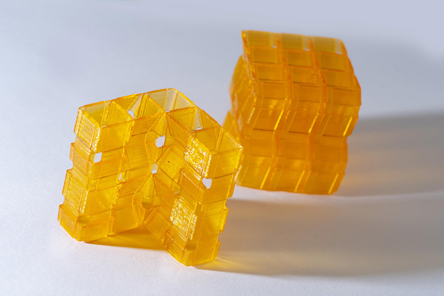 Closeup of two origami structures created through Digital Light Processing 3D printing. (Photo: Christopher Moore)