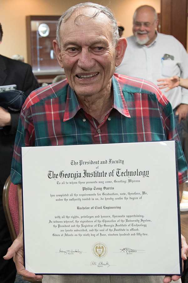 Philip Sarris holds the diploma he earned in 1952 but never actually received. (Photo: Scott Dinerman)