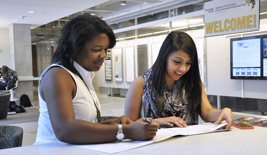 Advisor Shanta Hutchins works with a student in the lobby of the Mason Building. (Photo: Jess Hunt-Ralston)