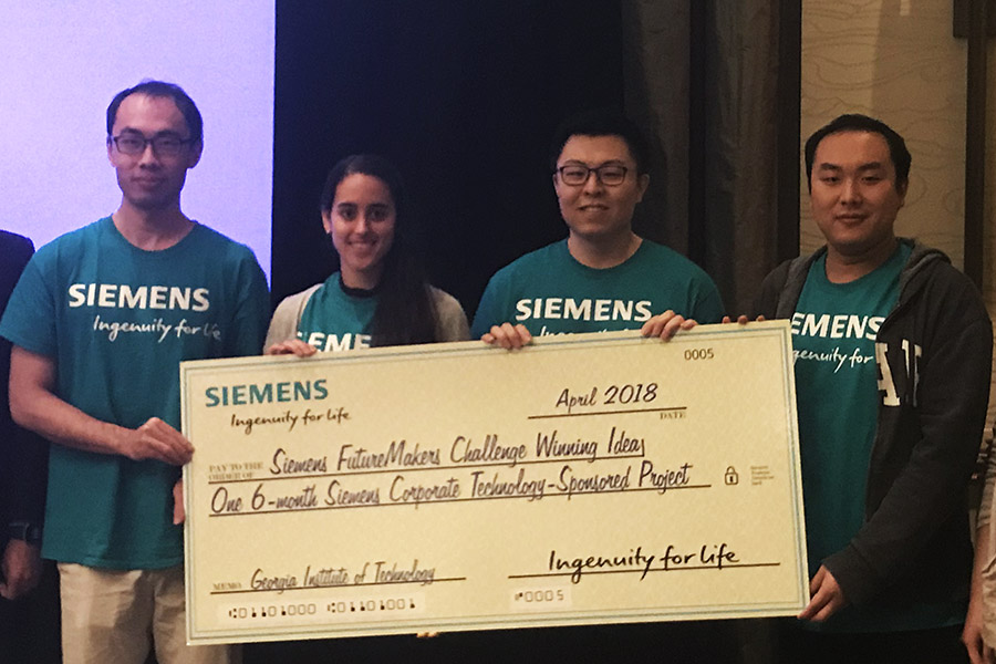 Civil engineering students Yang Jiang, Emily Sanders and Heng Chi plus computation science and engineering student Yuyu Zhang with their first-place check after the Siemens FutureMakers Challlenge. Their concept for the hackathon at Georgia Tech combined machine learning and topology optimization to make computational design and digital manufacturing more efficient and effective. (Photo Courtesy: Glaucio Paulino)