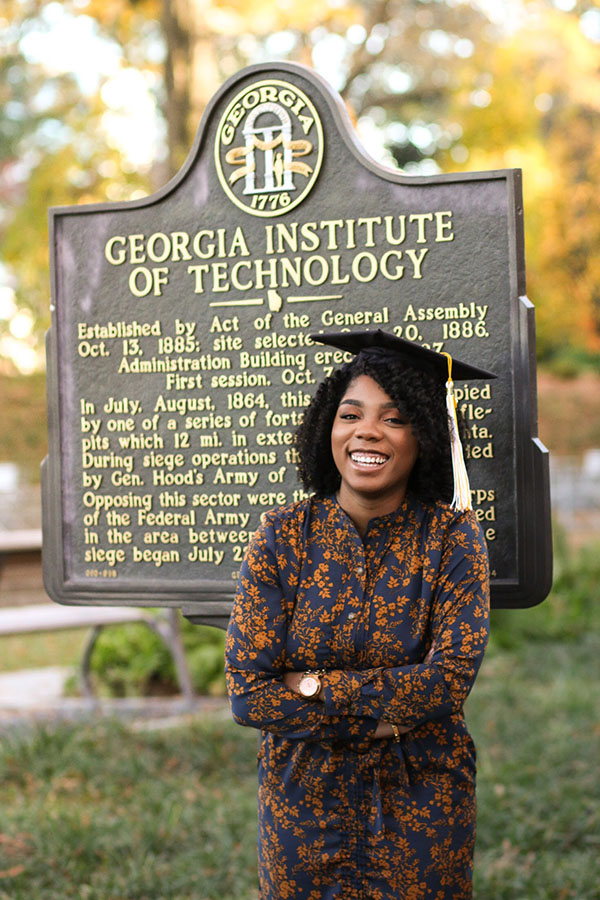 Sharani White poses with her graduation cap at the Georgia Tech historical marker near Tech Tower. (Photo: Titilayo Funso)
