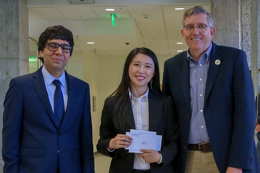 Xiaojia Shelly Zhang, center, receives her award from awards committee chair Arash Yavari, left, and School Chair Donald Webster.  (Photo: Amelia Neumeister)