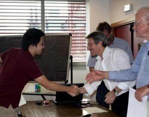 Fanzhou Liu shaking hands with his teachers at LARAM