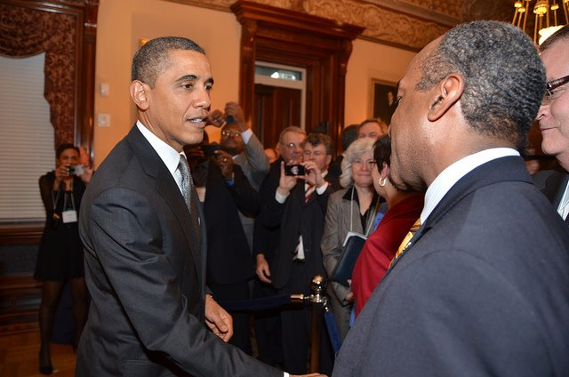 President Obama shaking hands with Dean Gary S. May at the White House.