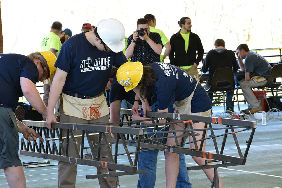 Members of the ASCE steel bridge team put together their design at the Carolinas Regional Conference for student chapters April 1. The team, led by Colin Martin and Mihai Mavrodin, won first place and advance to national competition in May. (Photo: Thomas S. Teichmann)