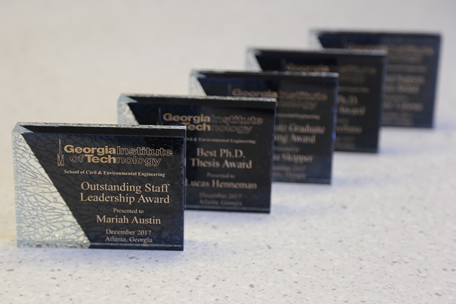 A row of awards plaques presented to students, faculty and staff at the 2017 CEE Awards Ceremony Dec. 11. (Photo: Jess Hunt-Ralston)