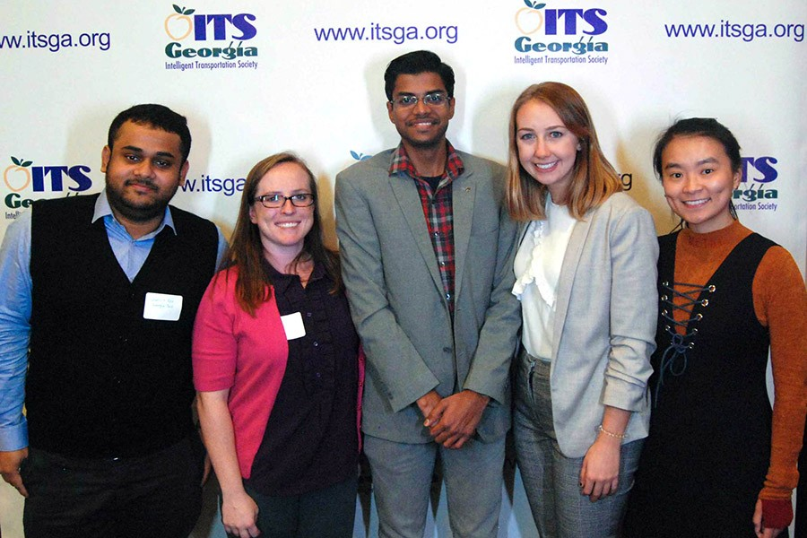 "These five School of Civil and Environmental Engineering students won scholarships from the Intelligent Transportation Society of Georgia for their essays about the ways intelligent transportation systems and technology could help the United States eliminate roadway deaths and serious injuries by 2025. From left, Ph.D. students Somdut Roy, April Gadsby and Cibi Pranav; undergraduate Katie Popp; and Ph.D. student Hanyan ""Ann"" Li. (Photo Courtesy: Intelligent Transportation Society of Georgia)"
