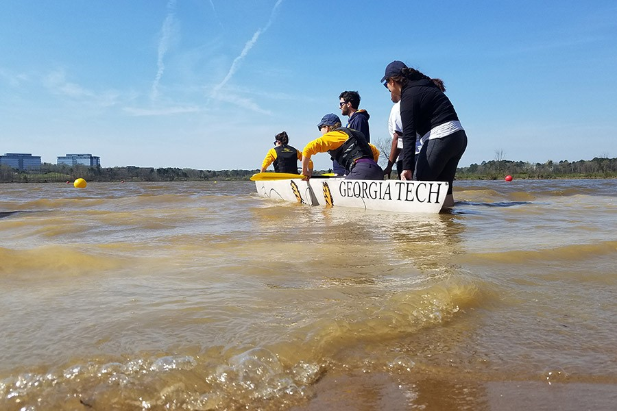 The ASCE concrete canoe team launches their vessel for the women's sprint race, where chapter president Caroline Stanton and conference chair Alesa Stallman placed second after winning their heat. (Photo: Vy Le)