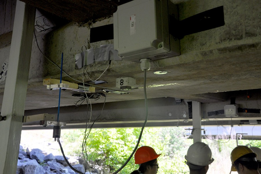 Yang Wang and students in his research group install sensors on a bridge in Bartow County, Georgia, in July 2016. Wang, Francesco Fedele and Rafi Muhanna in the School of Civil and Environmental Engineering will use data from instruments like these to feed a new interval-based optimization approach to assess structural systems and detect damage. (Photo Courtesy: Yang Wang)