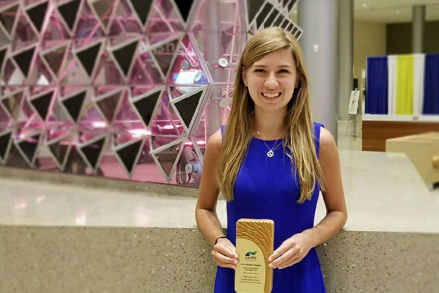 Grace Brosofsky, BSEnvE 2017, stands with her Student Sustainability Leadership award from the Association for the Advancement of Sustainability in Higher Education. (Photo Courtesy: Grace Brosofsky)