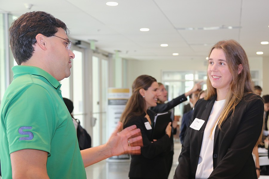 Skanska's Jimmy Mitchell talks with a student at the School's 2017 Career Expo. Mitchell, a 2005 civil engineering grad, has long been involved in mentoring Tech students. The School has launched a new program to involve more alumni in these kinds of relationships and is recruiting professionals and students. (Photo: Jess Hunt-Ralston)