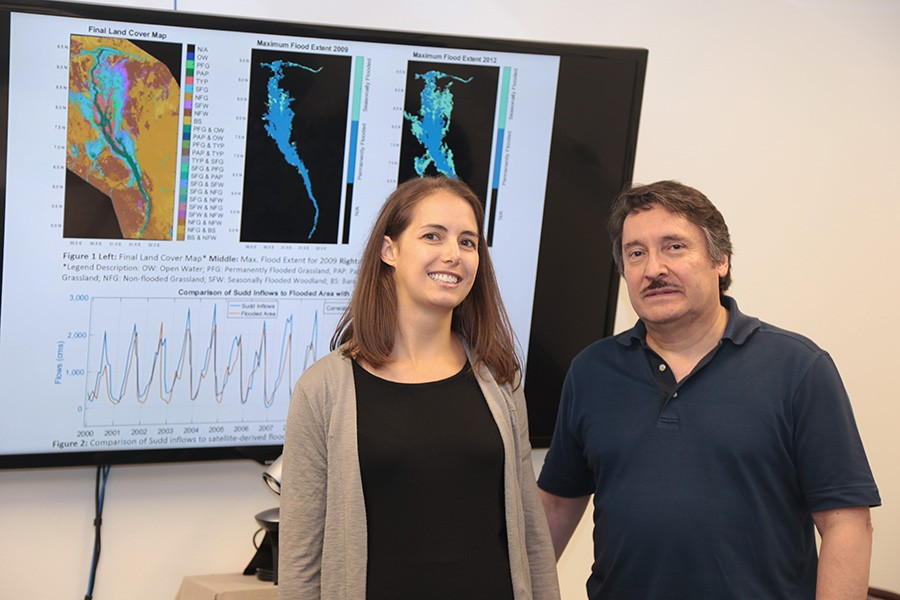 Courtney Di Vittorio, left, with her Ph.D. adviser, Aris Georgakakos and some of the data she's using for her research. Di Vittorio's work to incorporate satellite data into hydrologic models so decision-makers can improve water management plans has won her a 2017 Earth and Space Science Fellowship from NASA. (Photo: Jess Hunt-Ralston)