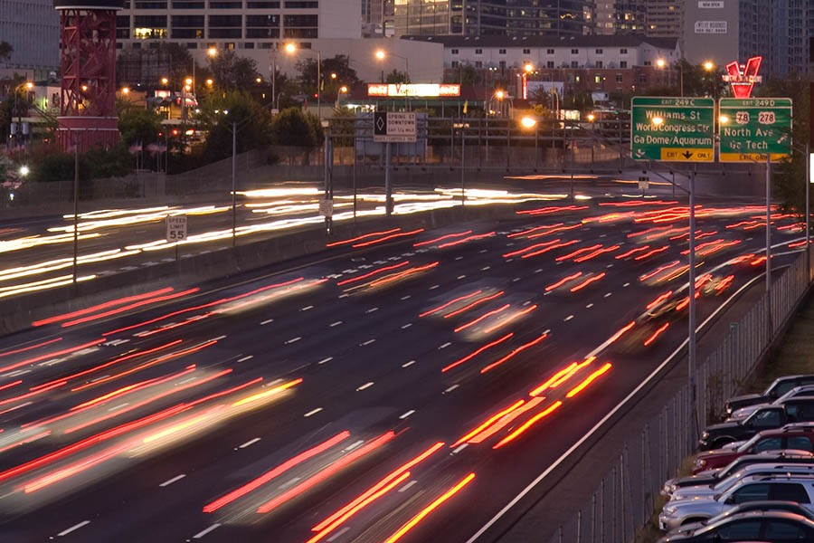 Cars speed along the Interstate 75/Interstate 85 Downtown Connector in Atlanta. (Photo: Rob Felt)