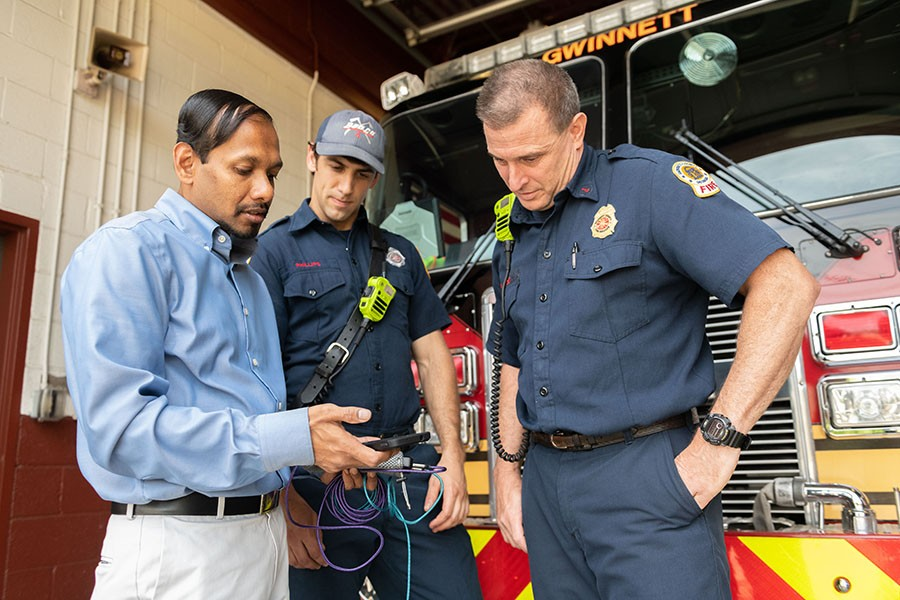Angshuman Guin demonstrates how a cell phone tracks Gwinnett County Fire Department trucks and data about traffic to improve response times. Guin is working with Gwinnett on connected vehicle technology as part of the first round of Georgia Tech's Georgia Smart Communities Challenge. (Photo: Allison Carter)
