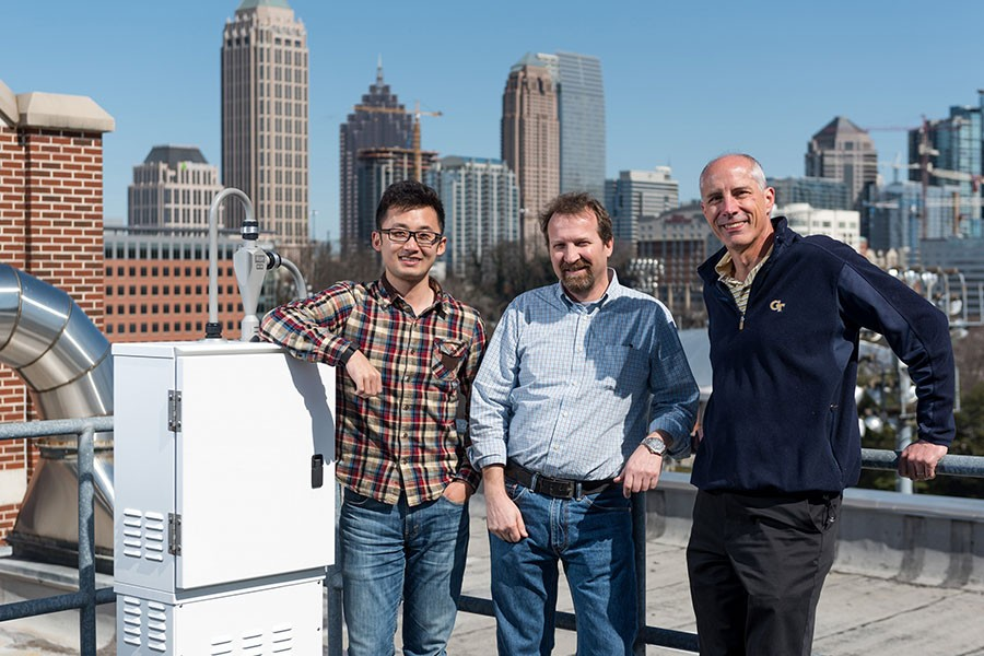 Hongyu Guo, Rodney Weber and Ted Russell on their research platform atop the Ford Environmental Science & Technology Building.