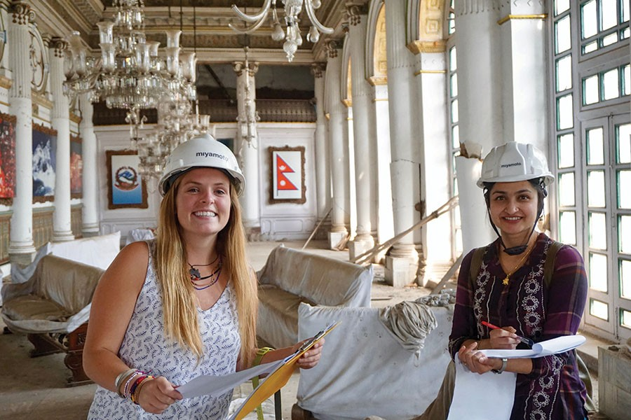 Undergraduate Maggie Lindsey, left, with structural engineer Priyanka Singh in the main room of the Gaddi Baithak in Kathmandu, Nepal. Lindsey was an intern with Miyamoto International in the country during spring 2017, where she worked on a project to restore the 100-year-old palace. (Photo: Binod Shrestha)