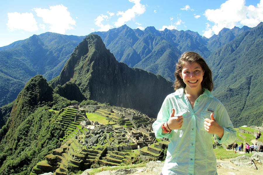 """Georgia Tech senior Maya Goldman at Machu Picchu in Peru. The structure behind her shows how Inca engineers used terraces as retaining walls. """"Being in Machu Picchu inspired me like no other place on Earth to continue my study of civil engineering,"""" Goldman said, """"to follow in the footsteps of those before me, and to build a future based on sharing knowledge and closely observing environmental processes, just like Incan engineers."""" (Photo Courtesy: Maya Goldman)"""