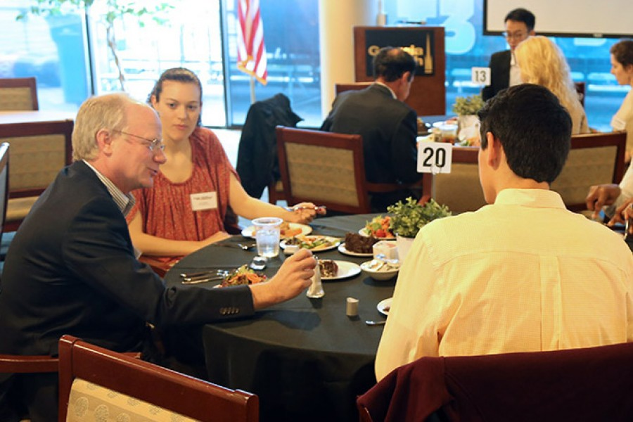 Art Williams talks with students at the School of Civil and Environmental Engineering's first scholarship and fellowship lunch. Williams and his family created the F. Everett Williams Scholarship for civil engineering students. (Photo: Joshua Stewart)