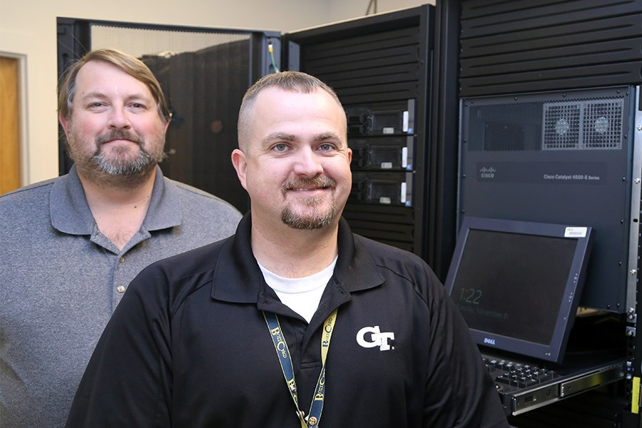Veterans John Temple and Mike Anderson in one of the School of Civil and Environmental Engineering server rooms. The pair now provide information technology support to the School's students, faculty and staff. (Photo: Joshua Stewart)