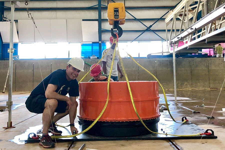 Hermann Fritz helping install the Volcanic Tsunami Generator at the O.H. Hinsdale Wave Research Laboratory at Oregon State University earlier this summer. (Photo: Angela Del Rosario / Courtesy: Natural Hazards Engineering Research Infrastructure)