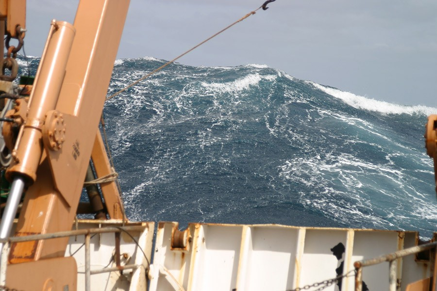 A large wave towers astern of the NOAA ship Delaware II in the Atlantic Ocean in 2005. (Photo: Delaware II Crew/NOAA)