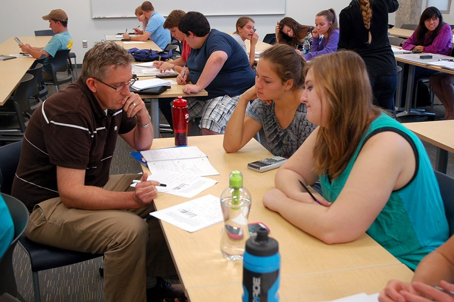 Professor Donald Webster working with students on a problem.