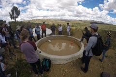 Students learn about a rainwater collector in the El Campo community from a local engineering during their Spring Break research trip to Bolivia. The trip, part of the Environmental Technology in the Developing World class, included days of collecting water samples and surveying residents as well as days learning how rural communities have developed their own water systems. (Photo: Donald Smith)