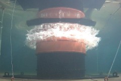 """The volcanic tsunami generator simulates a volcanic eruption by """"punching"""" through the water's surface. Professor Hermann Fritz built this one-of-a-kind setup and conducted a series of experiments to better understand tsunamis created by eruptions of underwater volcanoes. (Photo: Yibin Liu)"""