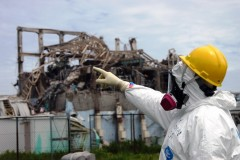 International Atomic Energy Agency fact-finding team leader Mike Weightman examines Reactor Unit 3 at the Fukushima Daiichi Nuclear Power Plant on May 27, 2011. The team assessed damage from an earthquake and tsunami in March 2011 that caused three reactors at the plant to meltdown. (Photo: Gregg Webb / International Atomic Energy Agency)