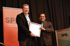 Professor and Associate Dean Laurence Jacobs, left, accepts a lifetime achievement award in nondestructive evaluation from Tribikram Kundu at the SPIE Smart Structures and Nondestructive Evaluation Symposium in early March. (Photo Courtesy: Laurence Jacobs and SPIE)