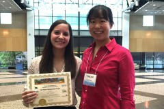 Chloe Johansen, left, and Iris Tien hold their first-place paper award at the Resilience Week 2017 conference for their work analyzing the vulnerabilities of interdependent infrastructure. They used Atlanta's water and power systems as a case study. (Photo Courtesy: Iris Tien)
